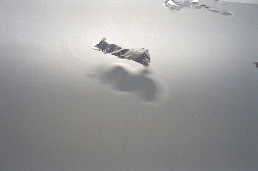Tin foil on water, Milan, Italy, 1998. Photo: Armin Linke